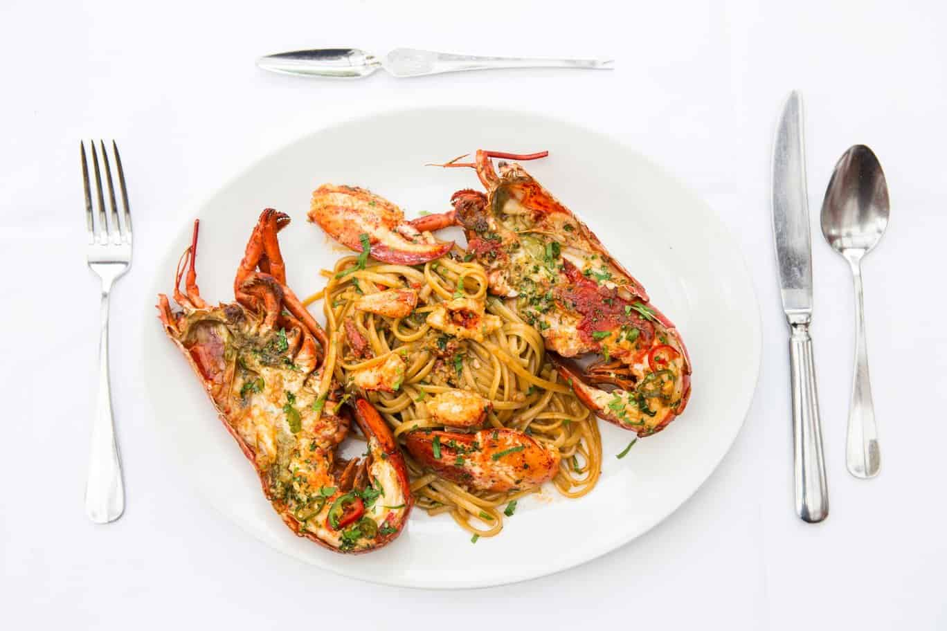 grilled lobster drowned herbed butter with garlic and chilli spaghetti